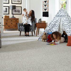 Family on grey Carpet | Price Flooring