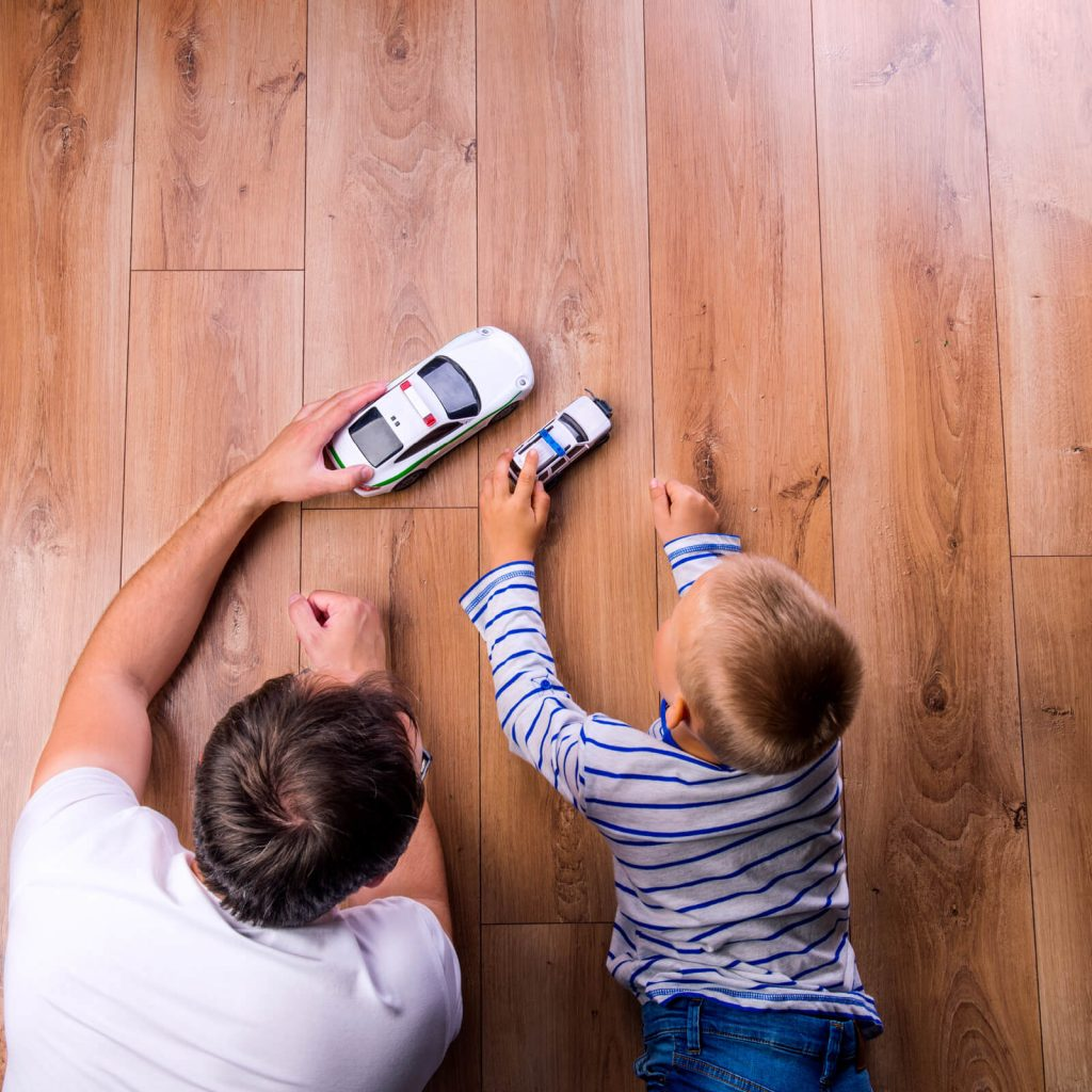 Father with kid playing with toycar | Price Flooring